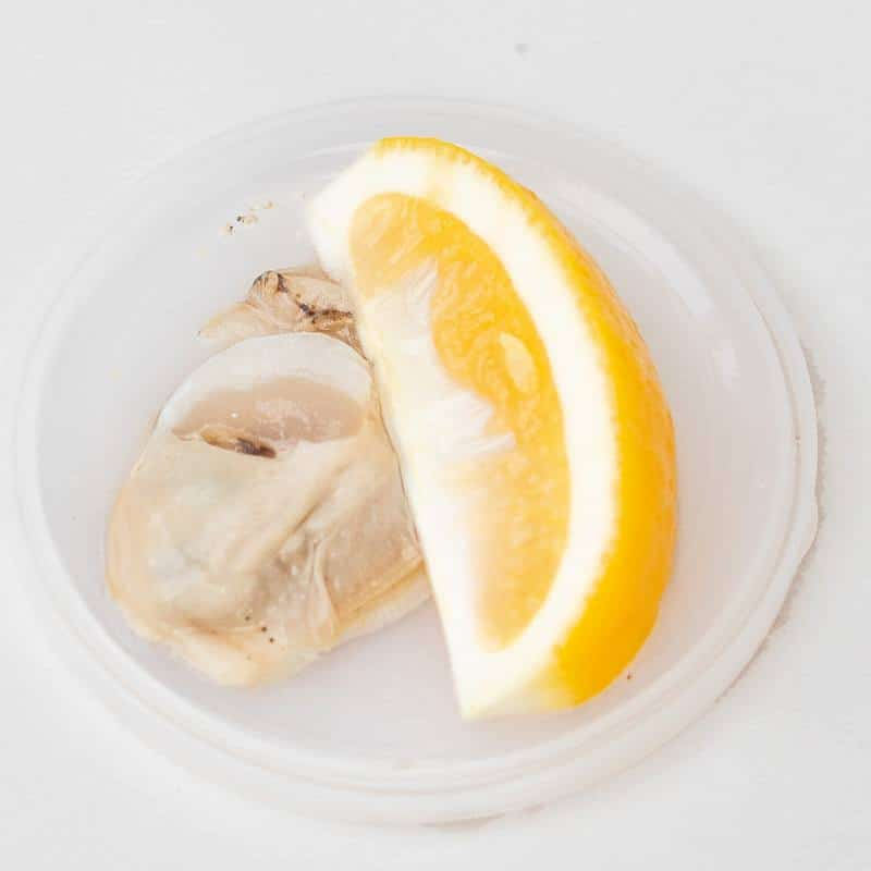 Raw oyster with fresh lemon
